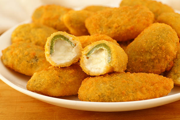 Jalapeno Poppers A plate of delicious fried jalapeno poppers.More deep fried goodness: jalapeno pepper stock pictures, royalty-free photos & images
