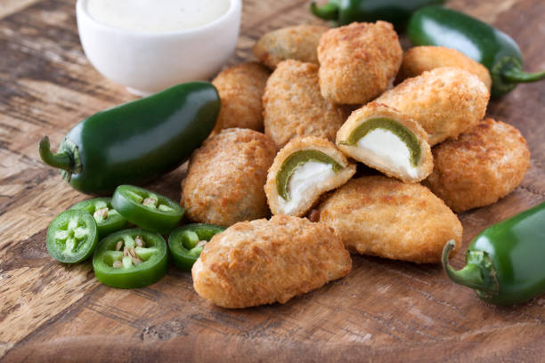 Jalapeno Poppers Jalapeno Poppers on Wooden Board jalapeno pepper stock pictures, royalty-free photos & images