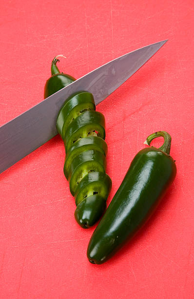 jalepeno being sliced stock photo