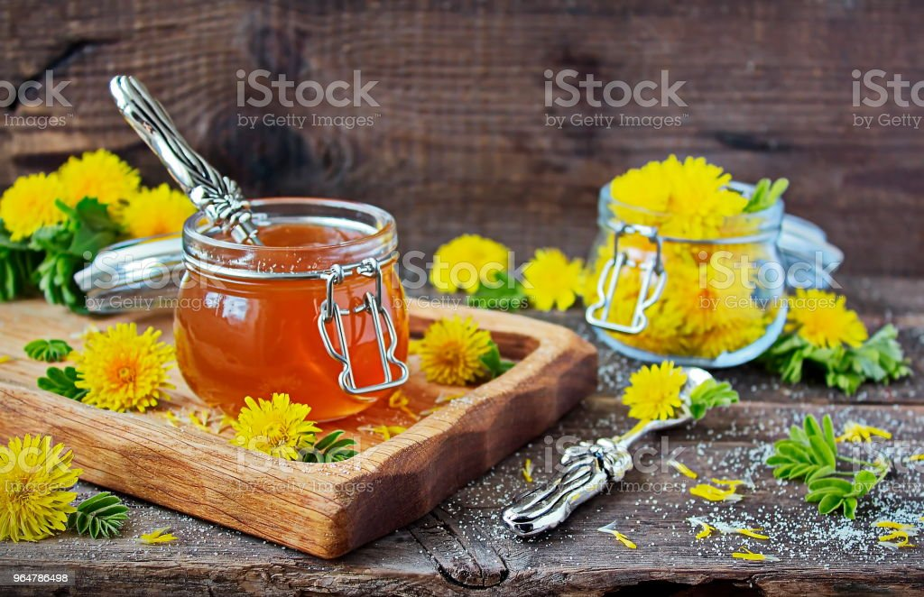 Jam dandelion in a glass jar royalty-free stock photo