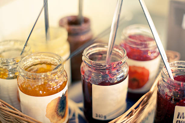 Jam Jars in a basket Jam Jars in a basket gelatin stock pictures, royalty-free photos & images