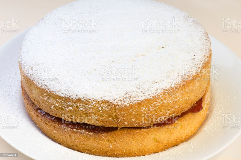 Jam oozing from Victoria sponge cake royalty-free stock photo