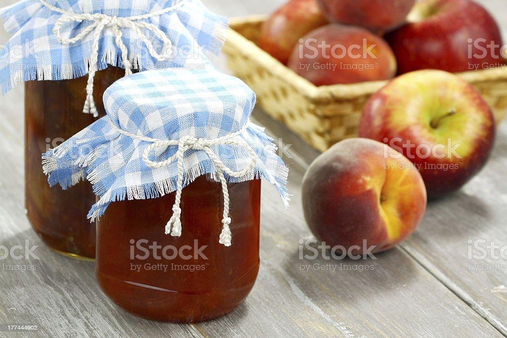 Jam, peaches and apples stock photo