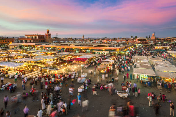 Jamaa el Fna market square in sunset, Marrakesh, Morocco, north Africa. stock photo