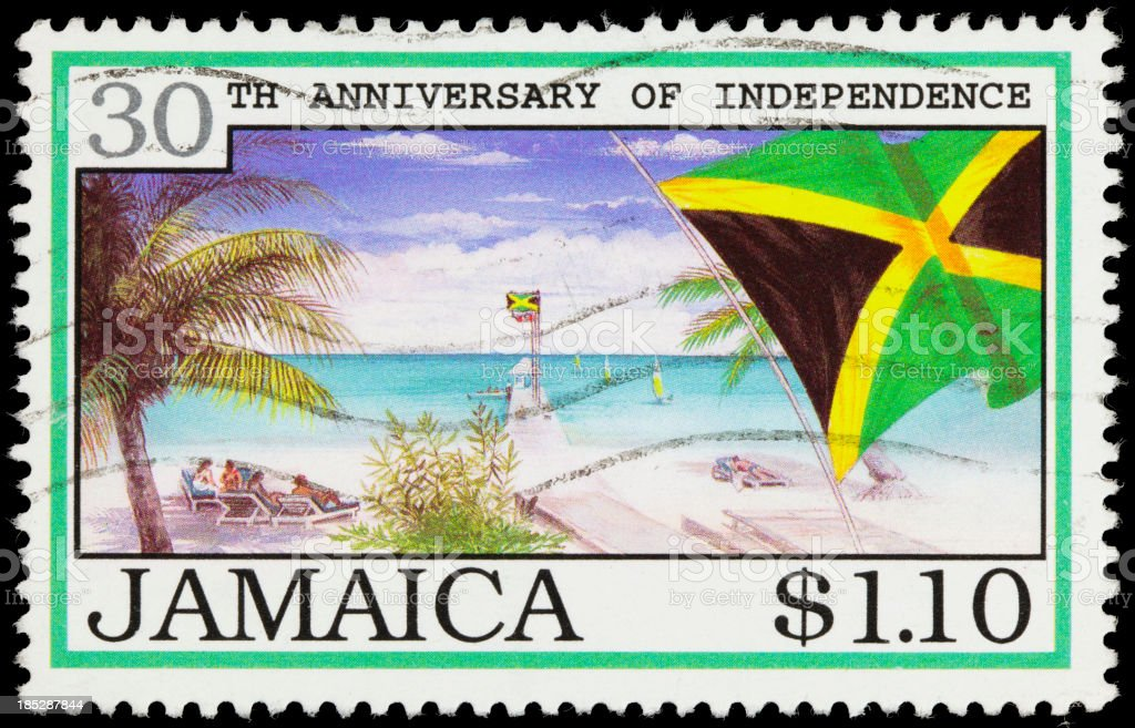 Jamaica flag and beach postage stamp stock photo