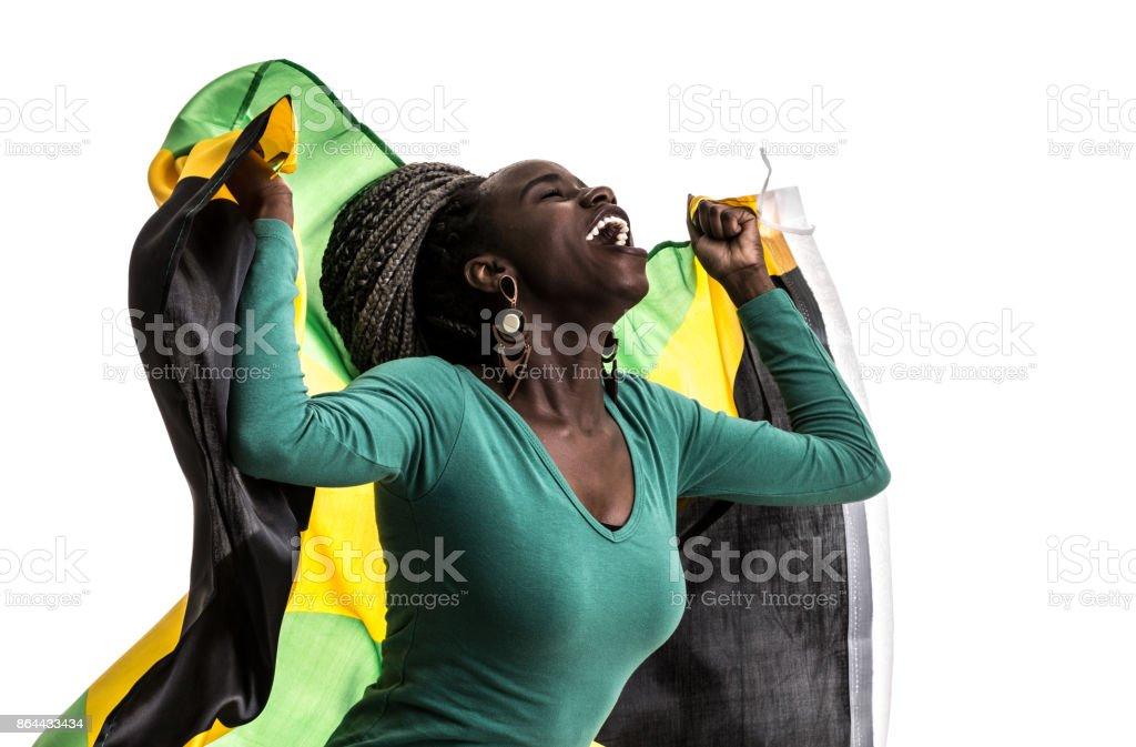 Ventilador jamaicano celebrando con la bandera nacional - foto de stock