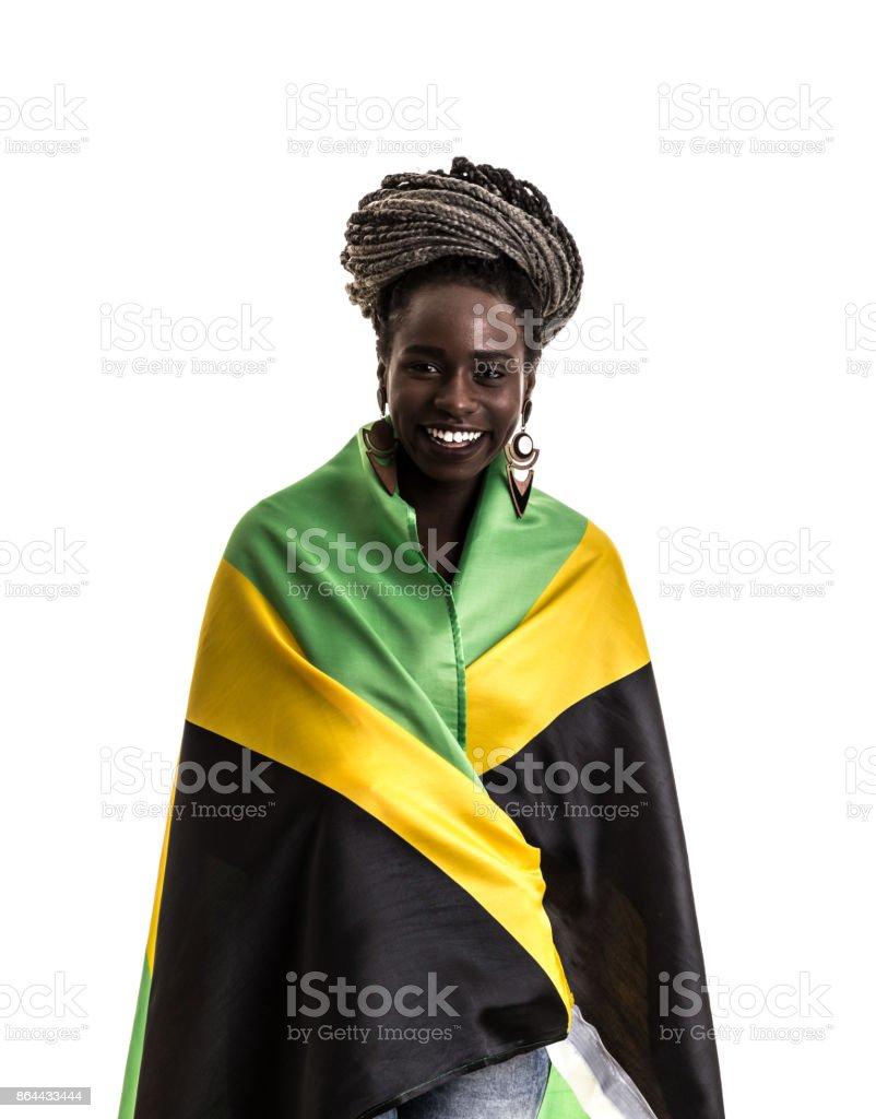 Jamaicano fã celebrando com a bandeira nacional - foto de acervo