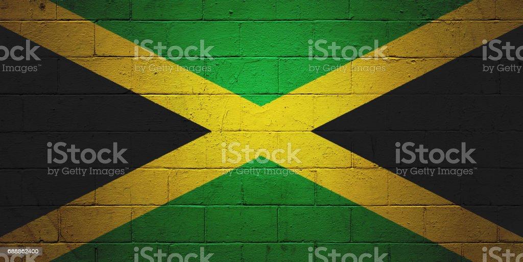 Bandeira jamaicana, pintada em uma parede - foto de acervo