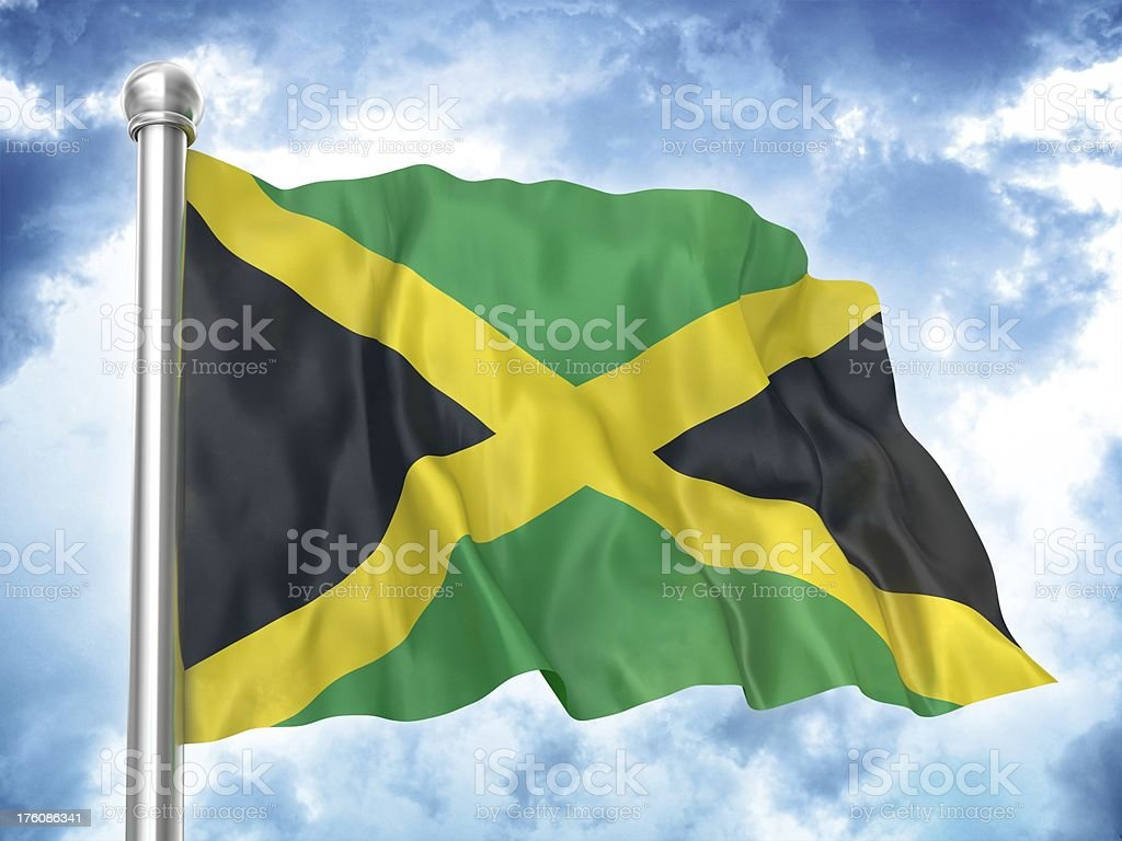 Bandeira Jamaicana balançando no céu - foto de acervo