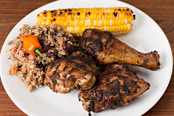 Jamaican Jerk Chicken, Rice And Peas And Grilled Corn stock photo