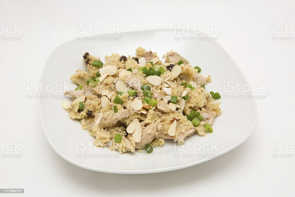 Jamaican jerk chicken with couscous raisins and green onions stock photo