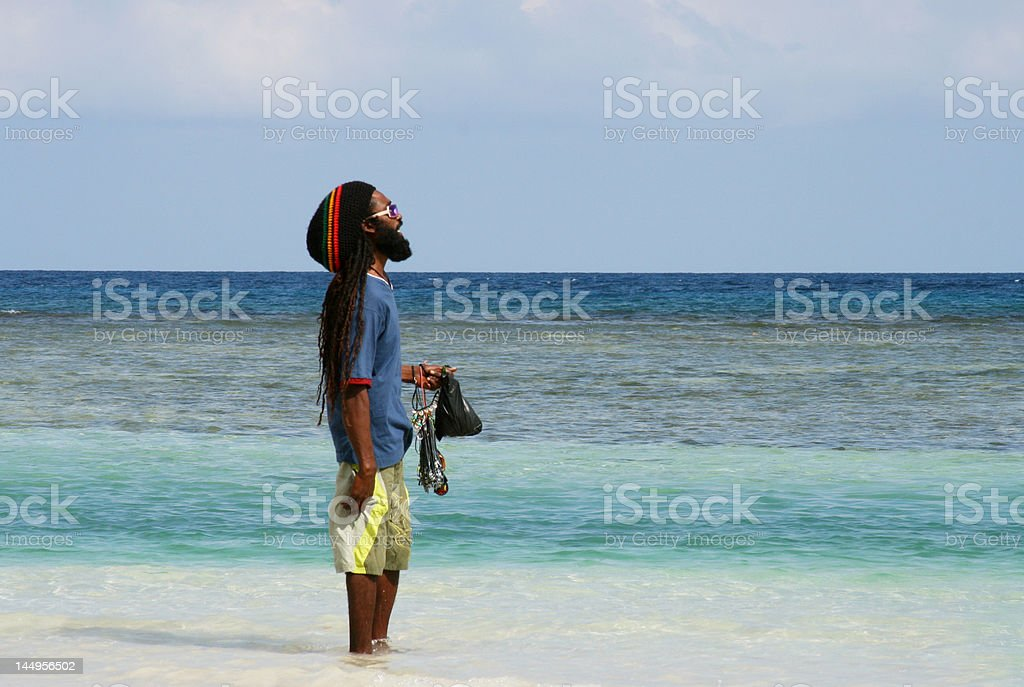 Jamaican man overlooking the sea - Royalty-free Adult Stock Photo