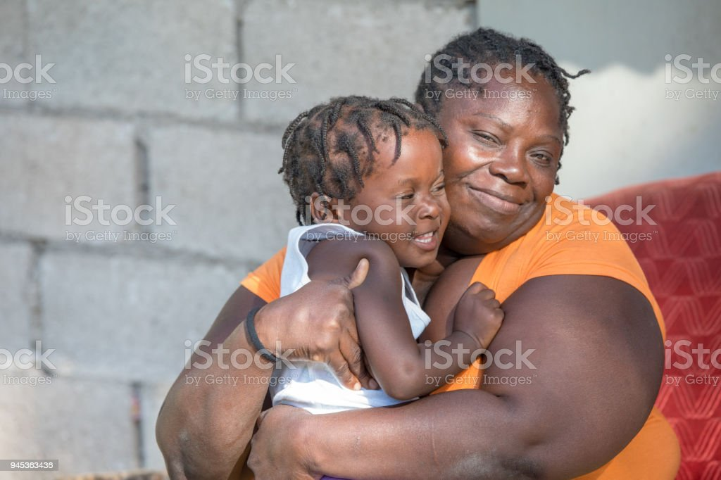 Jamaican Mother from remote village holds her young daughter stock photo