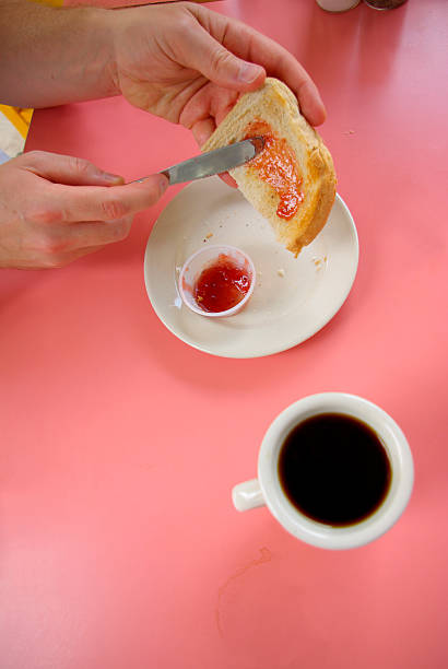 jamming bread with coffee - mikefahl stock pictures, royalty-free photos & images