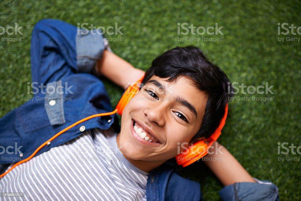 Jamming to his favorite tunes stock photo
