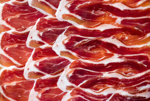 Jamon, close-up slices of meat, Spanish dish Jamon, close-up slices of meat, Spanish dish iberian stock pictures, royalty-free photos & images