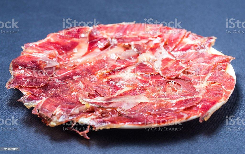 jamon serrano iberico plate tapas pincho top view stock photo