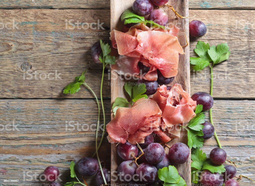 Jamon serrano with parsley and grape. royalty-free stock photo