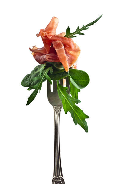 jamon with spinach and  arugula  isolated on white - vork stockfoto's en -beelden