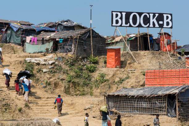 Jamtoli refugee camp in Bangladesh Rohingya Muslims carry humanitarian aid to their shelters at Jamtoli refugee camp near Cox's Bazar, Bangladesh (October 26, 2017) rohingya culture stock pictures, royalty-free photos & images