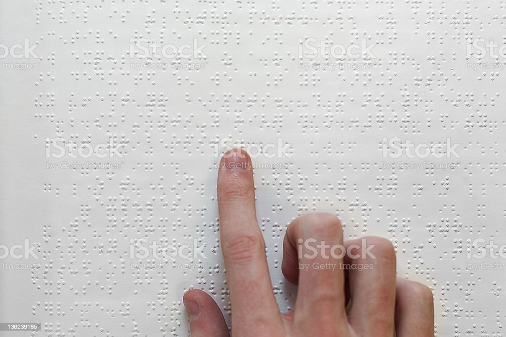 Jand over braille text stock photo