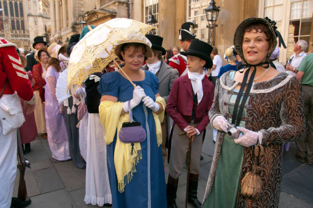 Jane Austen Festival in Bath, UK Jane Austen Festival held annually in Bath to celebrate the authors time living in the City, the participants parade to the Royal Crescent. bath england stock pictures, royalty-free photos & images
