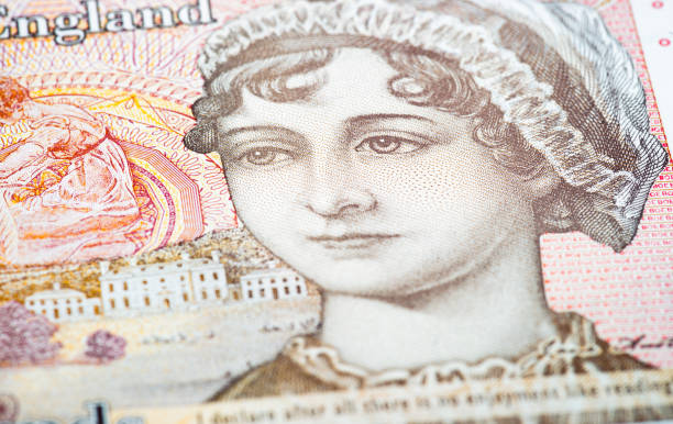 Jane Austen on UK Ten Pound note Close-up on the surface of a 2017 polymer £10 note, featuring the 19th Century author Jane Austen. ten pound note stock pictures, royalty-free photos & images