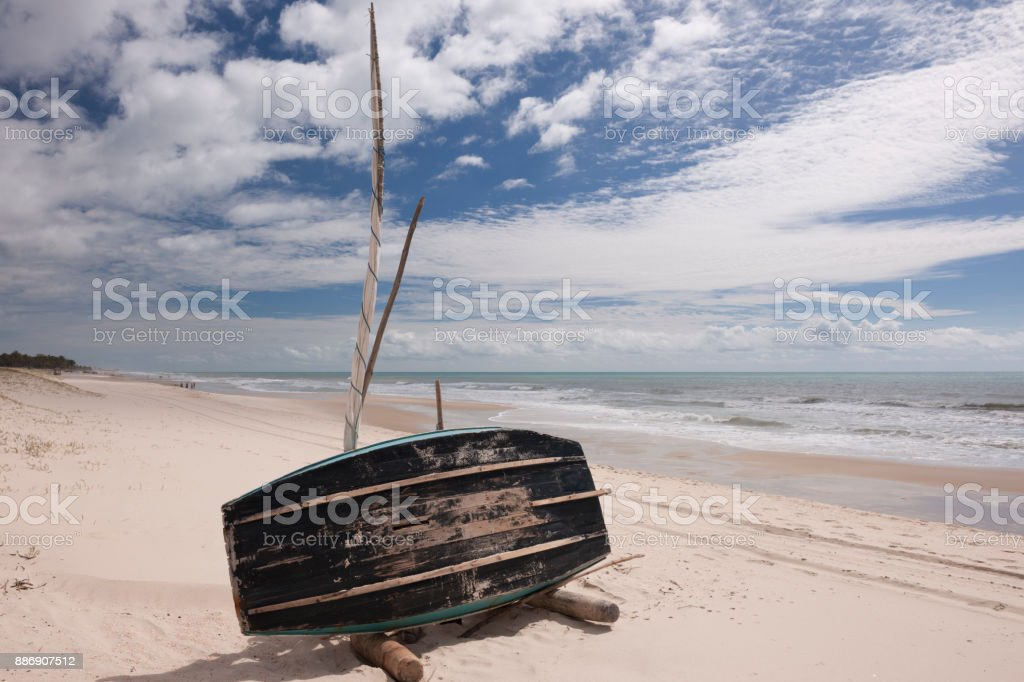 Jangada lying on the side to dry on the Brazilian beach stock photo