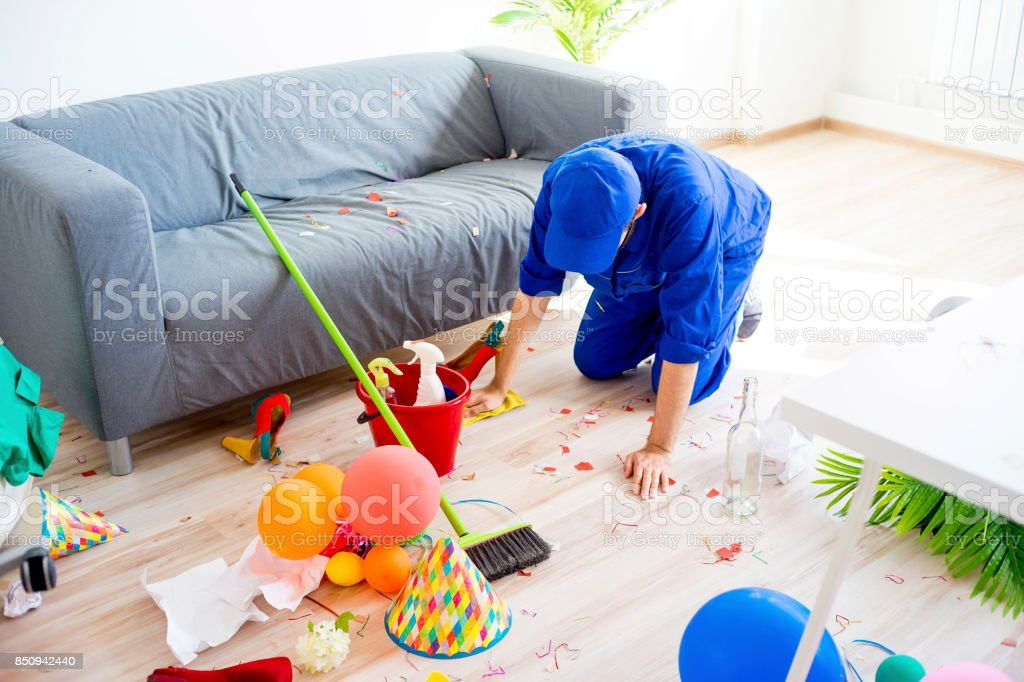 Janitor cleaning a mess stock photo