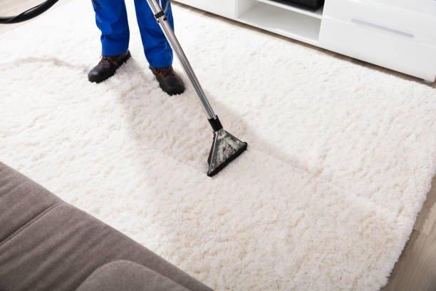 Janitor Cleaning Carpet With Vacuum Cleaner stock photo