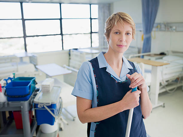 Janitor cleaning hospital room stock photo