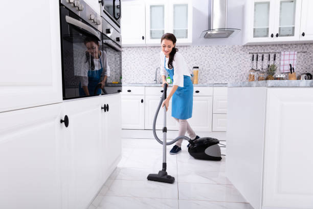 janitor cleaning kitchen floor with vacuum floor - maid stock pictures, royalty-free photos & images