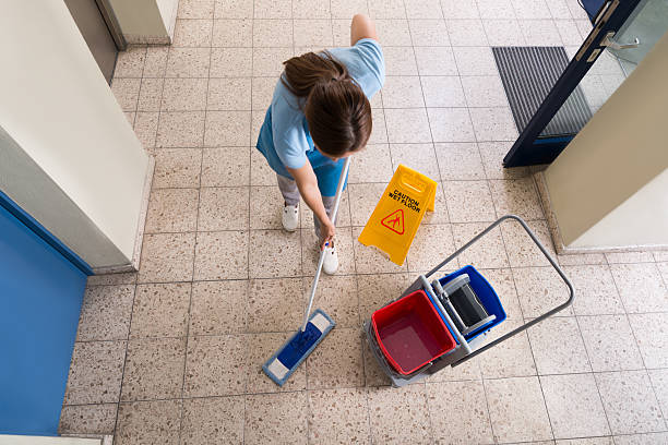 Janitor Mopping Floor With Cleaning Equipments stock photo