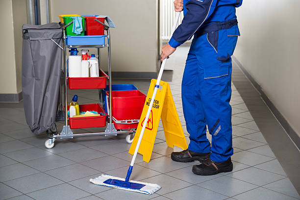 janitor with broom cleaning office corridor - sweeping stock pictures, royalty-free photos & images
