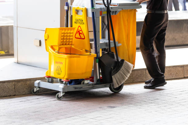 Janitorial and mop bucket on cleaning in process and worker on work. Janitorial and mop bucket on cleaning in process and worker on work. mop stock pictures, royalty-free photos & images