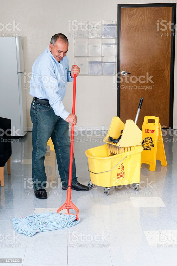 Janitorial Service - Maintenance Man Cleaning Office Floor royalty-free stock photo