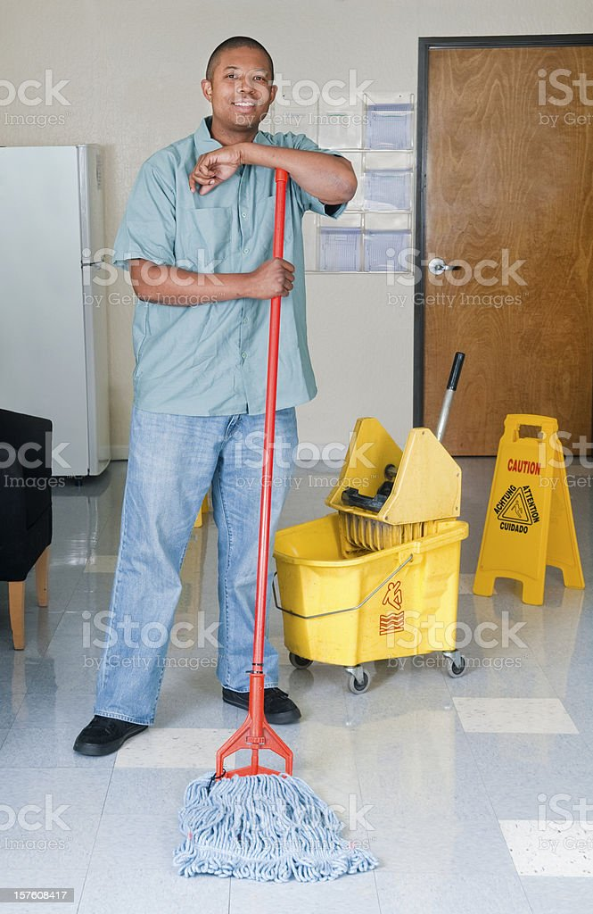 Janitorial Services Maintenance Man Cleaning Office Floor royalty-free stock photo