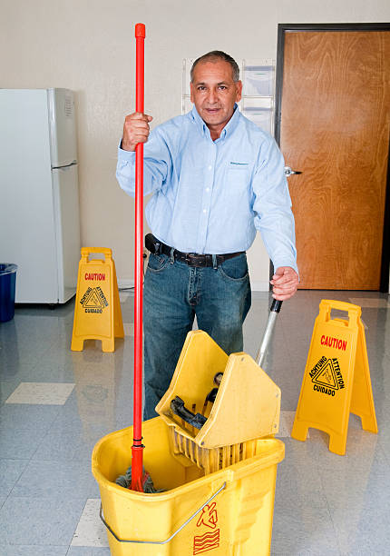 Janitorial Services - Maintenance Man Cleaning Office Floor stock photo