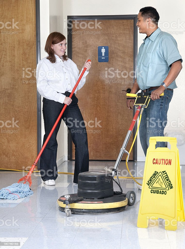 Janitorial Services - Man and Woman Talking stock photo