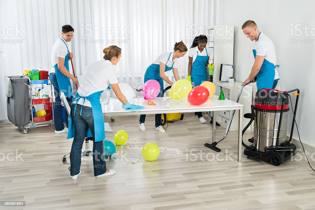 Janitors Cleaning The Office After Party - Photo