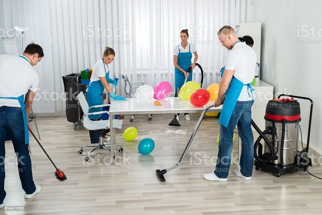 Janitors Cleaning The Office After Party stock photo