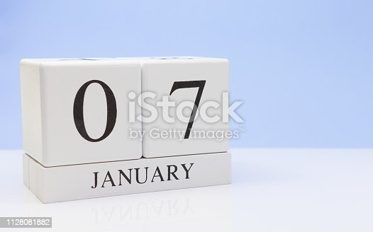 1027407218 istock photo January 07st. Day 07 of month, daily calendar on white table with reflection, with light blue background. Winter time, empty space for text 1128081882