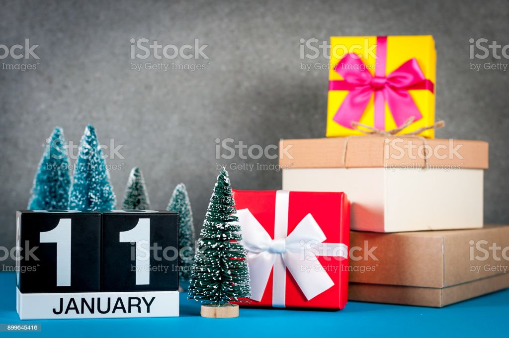 January 11th. Image 11 day of january month, calendar at christmas and new year background with gifts and little Christmas tree stock photo