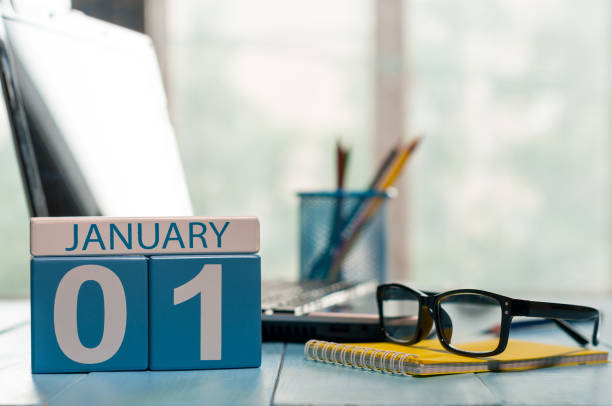 january 1st. day 1 of month, calendar on teacher workplace background. winter time. empty space for text - new year day stock photos and pictures