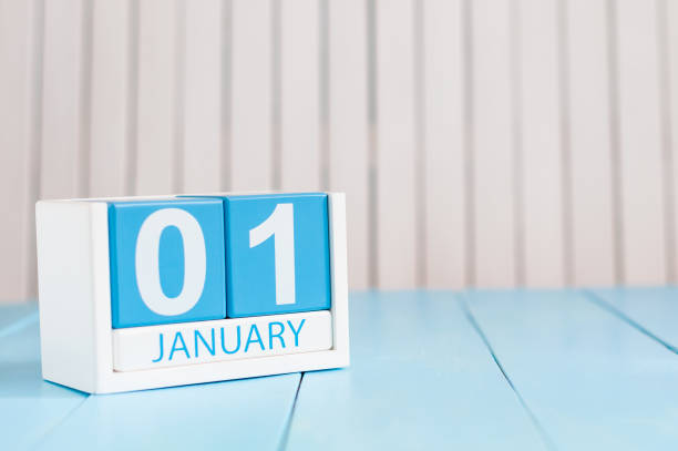 january 1st. day 1 of month, calendar on wooden background. winter time, new year concept. empty space for text - new years day stock pictures, royalty-free photos & images