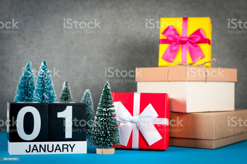January 1st. Image 1 day of january month, calendar at christmas and new year background with gifts and little Christmas tree stock photo