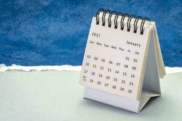 January 2021 - spiral desktop calendar stock photo