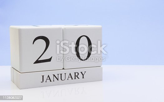 1027407218istockphoto January 20st. Day 20 of month, daily calendar on white table with reflection, with light blue background. Winter time, empty space for text 1128082027
