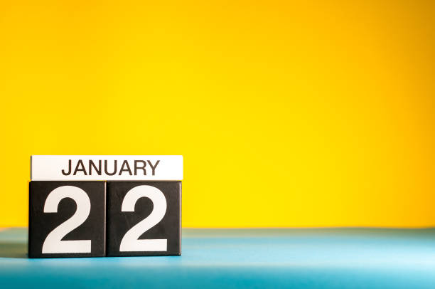 January 22nd. Day 22 of january month, calendar on yellow background. Winter time. Empty space for text stock photo