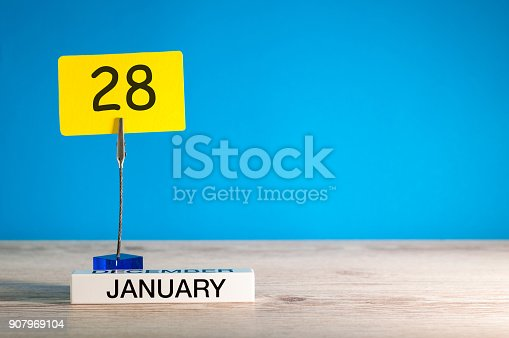 istock January 28th. Day 28 of january month, calendar on blue background. Winter time. Empty space for text, mock up 907969104
